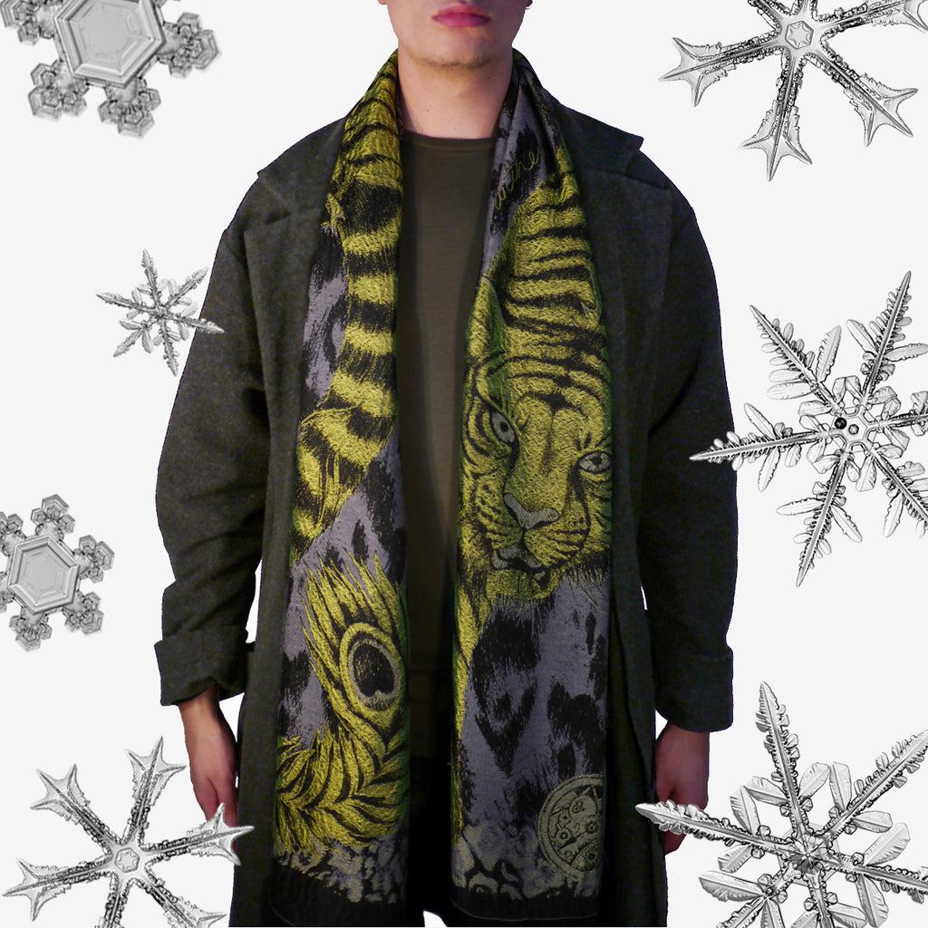 The Jacquard Woven Tigris scarf by Emma J Shipley features a striking tiger, prowling down the drape of the scarf.