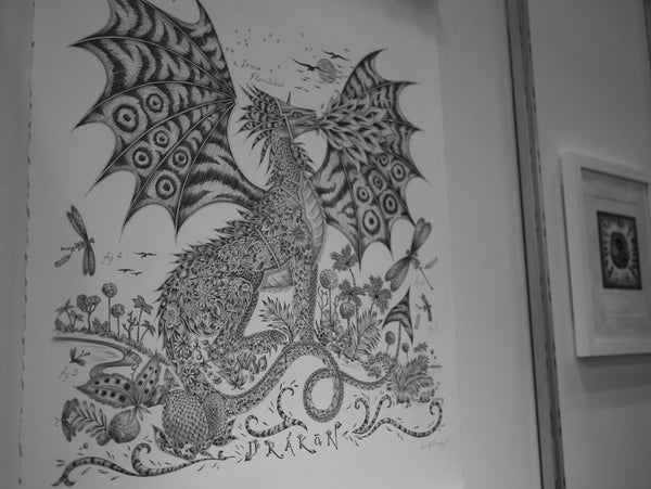 Left: The original Drakon drawing on display. Right: The Maki Mococo illustration developed into a wallpaper design