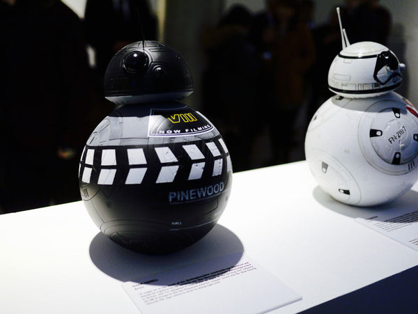 Left: Mark Hamill's BB-8, inspired by Pinewood studios and the filming of Star Wars: Episode VIII Right: John Boyega's BB-8, inspired by his Stormtrooper costume in the film.