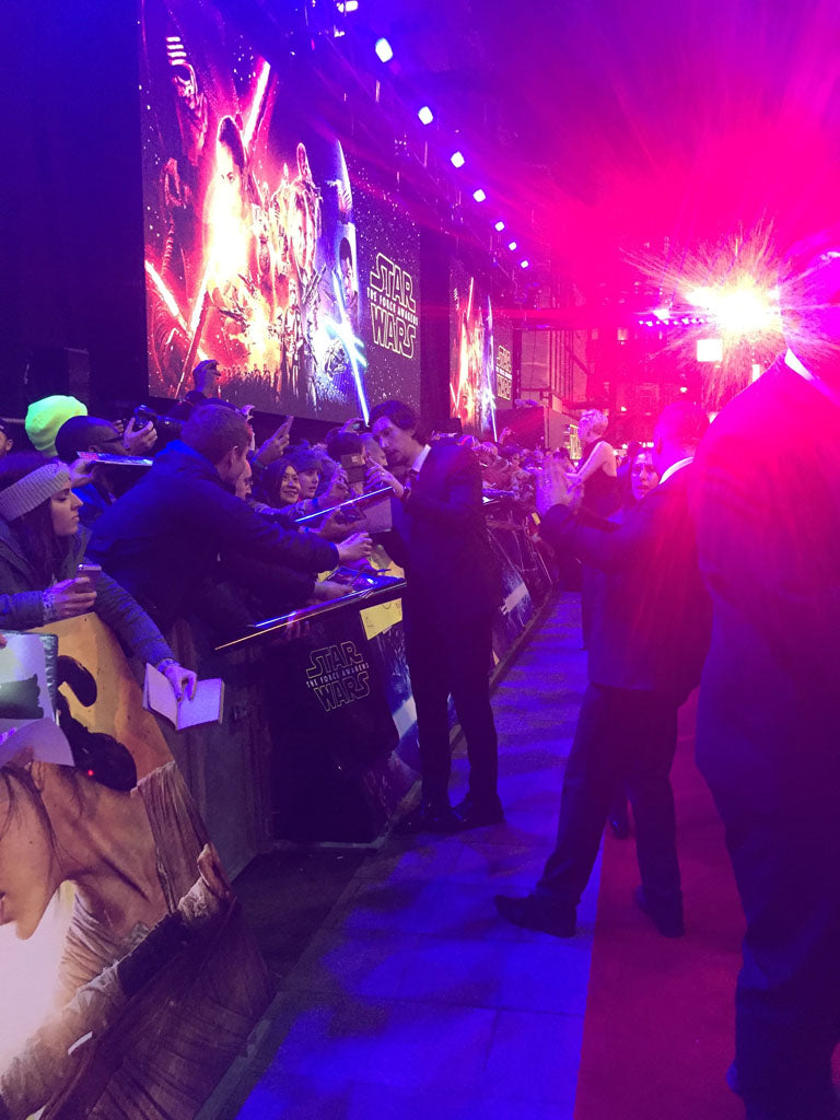 Adam Driver engaging with the fans, signing autographs and posing for pictures in Leicester Square, London.