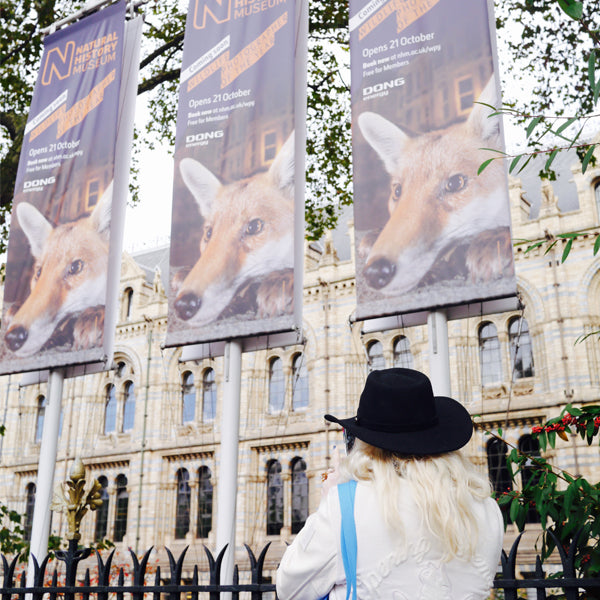 Left and right: The exterior of The Natural History Museum, donned with banners advertising the exhibition.