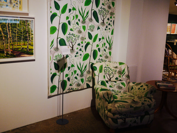 "Left: ""Window"" from 1943-45, transferred onto a large seat and fabric. The print depicts several common house plants. Right: ""Carpet Number 7"" by Frank was inspired from the Medusa heads found in ancient Roman homes."