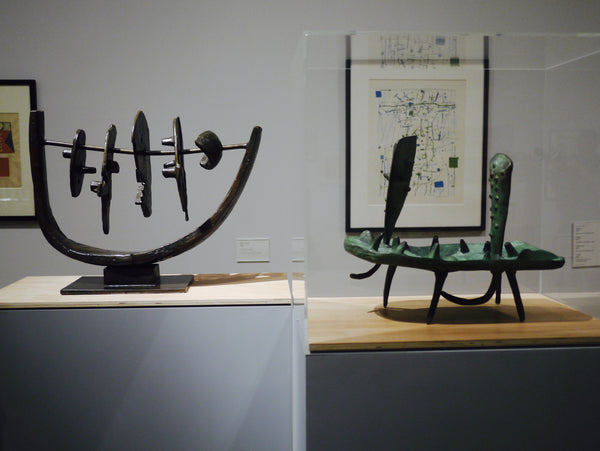 Left and right: Early sculptures by Paolozzi from his retrospective exhibition at The Whitechapel Gallery.