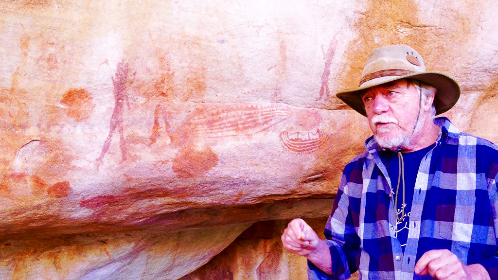 Professor John Parkington, in his element, explaining some unusual motifs in the paintings on the cave behind him