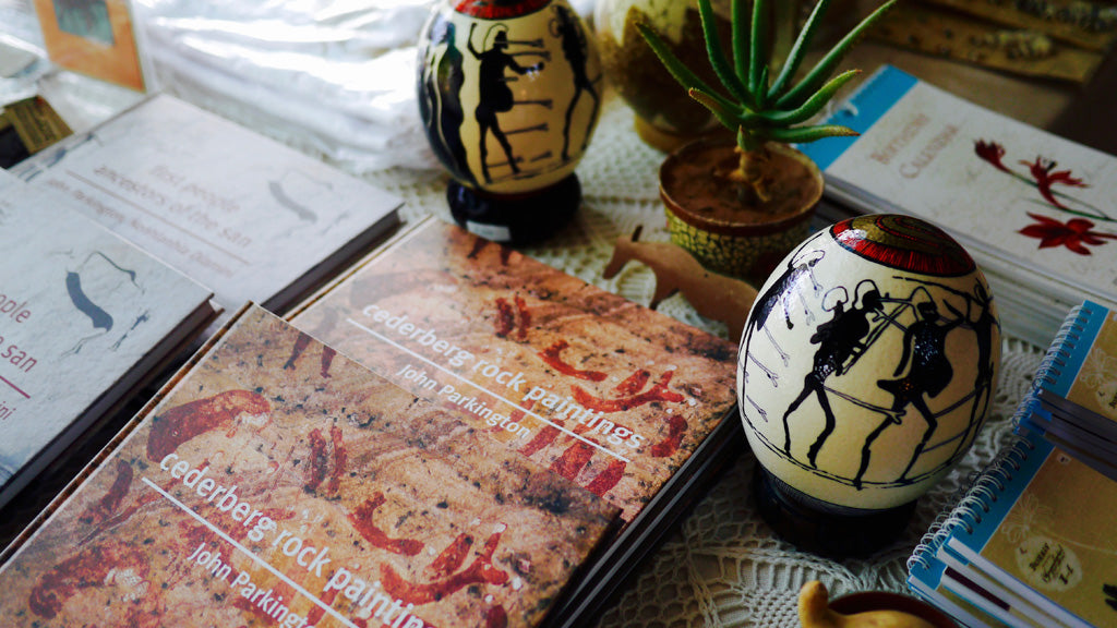 Some of John Parkington's books, and painted ostrich egg shells inspired by San rock art, on sale at the Clanwilliam Living Landscape Project pop up