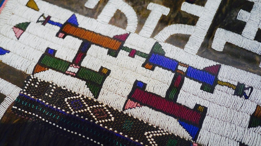 Marriage aprons by unknown Ndebele artists, in glass beads on hide