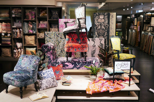Top left: The magical pop-up installation in all its glory. View the Emma J Shipley for C&C furniture collection in Harrods. Top right: Details of the beautiful chairs, upholstered with our Animalia fabric. Bottom left: Our bestselling Giraffe Cushion atop a pile of exciting EJS treats, including this stunning Kruger jacquard woven throw, coming soon. Bottom right: Once upon a time there was a magical cheetah...