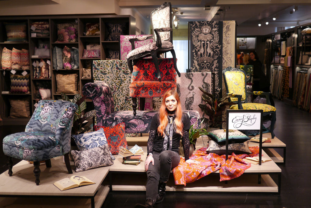 Emma J Shipley in front of her new range of fantastical furniture pieces in collaboration with Clarke & Clarke, exclusively launched in Harrods