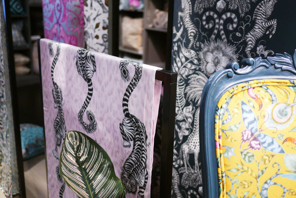 Left: Beautiful details of the Animalia collection on display in Harrods. Here you can see the Tigris Cotton Satin Fabric in pink and the Kruger Wallpaper in navy. Right: 2 of our magical chairs designed by Emma J Shipley in collaboration with Clarke & Clarke, against a stunning back drop of Animalia wallpaper...