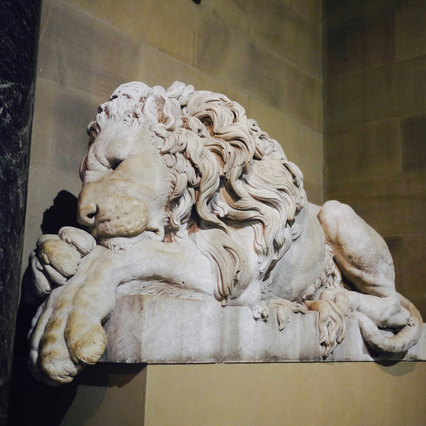 Left and Right: Expressive lion sculptures at Chatsworth House