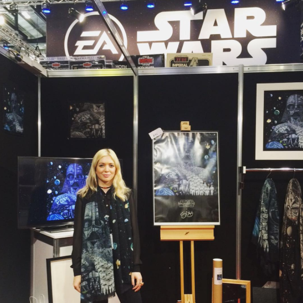 Left: the Emma J Shipley stand at Star Wars Celebration. Right: Emma sketching on the stand to give away to eager fans.