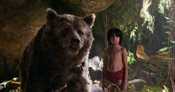 Left: The Jungle Book's Baloo and Mowgli. Right: Mowgli (newcomer Neel Sethi) and Bagheera (voice of Ben Kingsley). Copyright 2016 Disney Enterprises, Inc. All rights reserved.