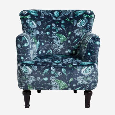 Front view of the Extinct Dalston Chair by Emma J Shipley for Clarke & Clarke is a stunning armchair which makes a bold statement in your interior