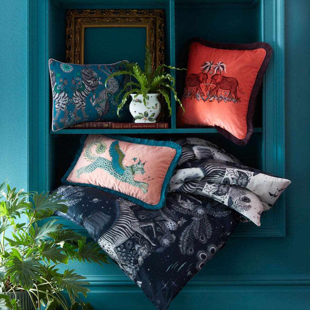 A stunning lifestyle shot of the new Emma J Shipley Bedding sets done in collaboration with Clarke & Clarke, along with an array of cushions the new Lost World Navy Duvet Cover which can be paired with any of the new bedding accessories