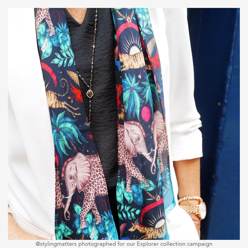 close up details of the Zambezi silk skinny scarf in navy from the campaign shoot for the new explorer collection