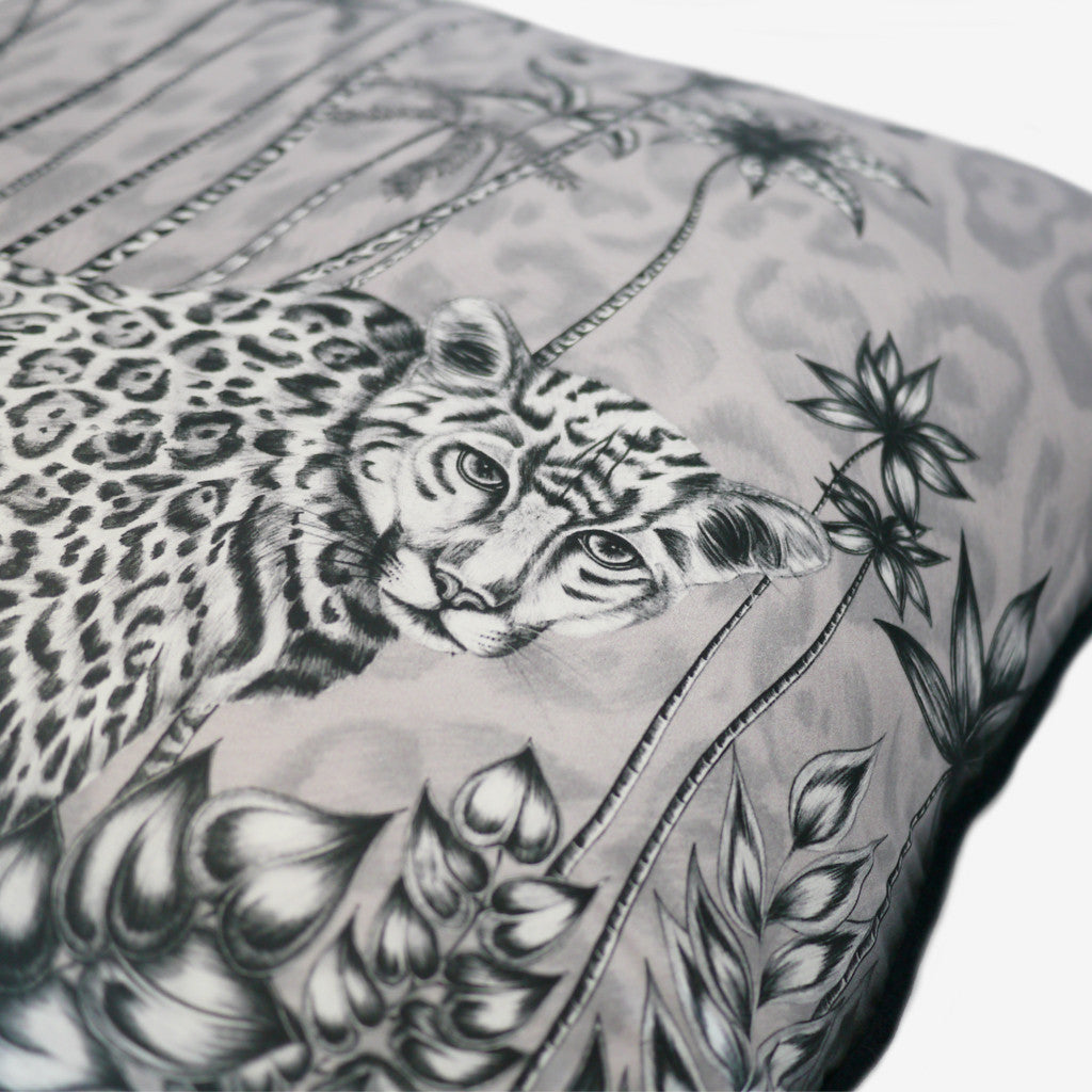 The Jaguar Large Cushion features an elegant jaguar in the jungle, set upon a starry night sky.