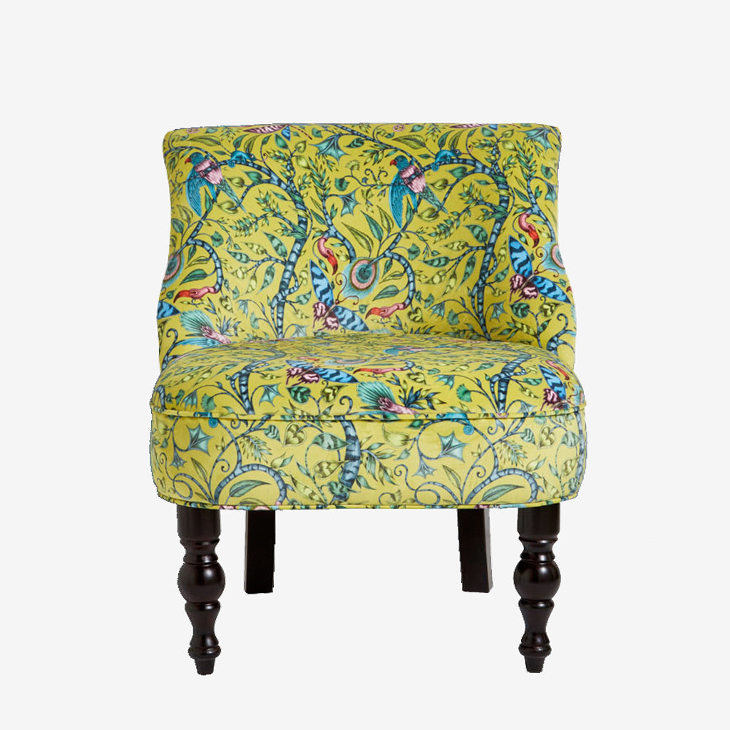 Front view of the Rousseau Langley Chair in Lime from the Emma J Shipley and Clarke & Clarke Animalia fabric furniture range