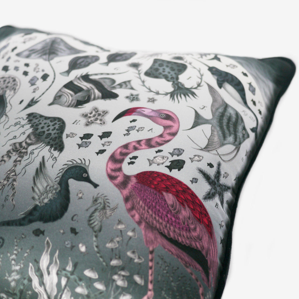 The hand-drawn curious flamingo surveys an underwater scene, full of striped fish, starfish and unusual seahorses.