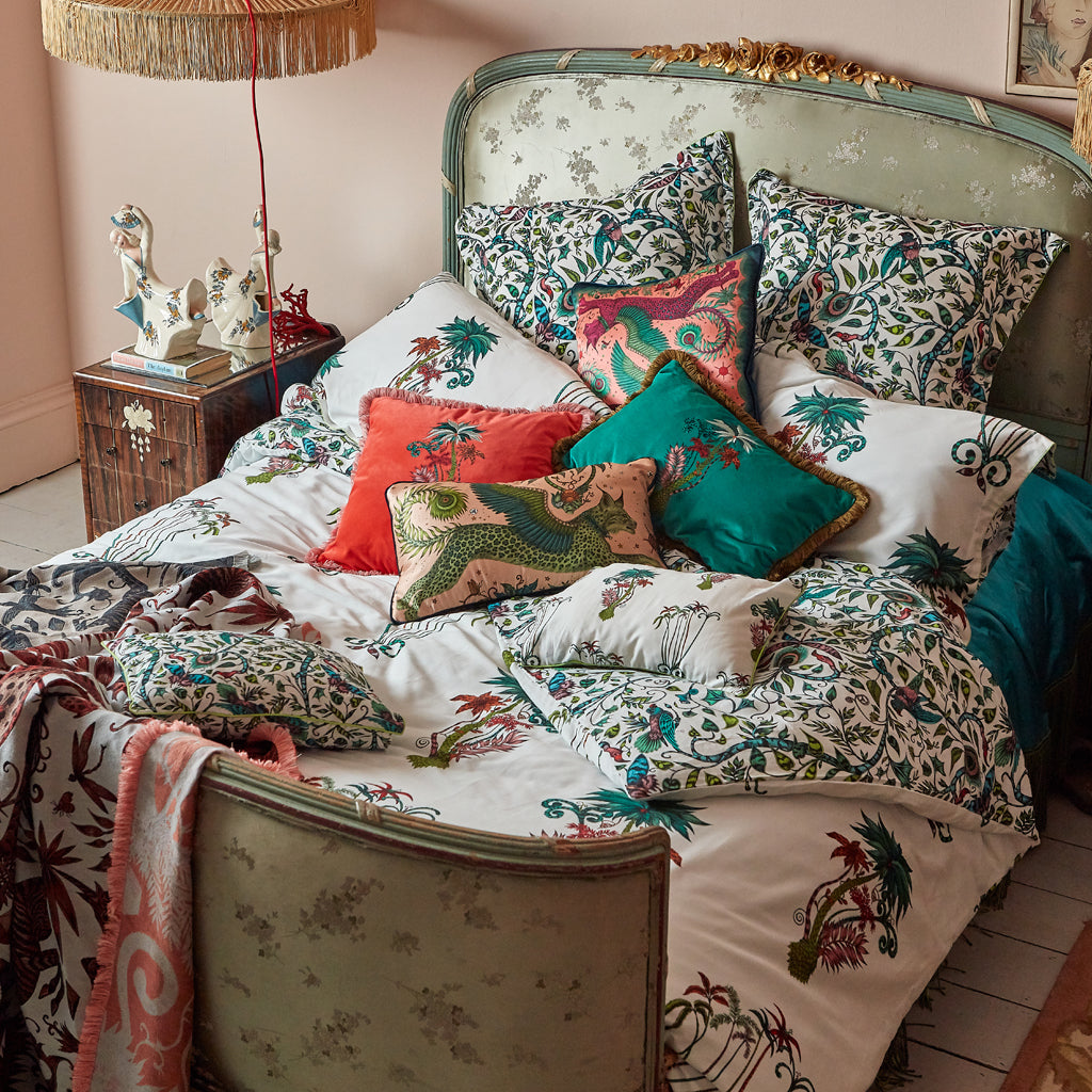 The Jungle Palms bedding layered with the Lynx Silk cushions mixed in, showing you the striking creations you can make with this range, mix and match it with the other Emma J Shipley products to create a dreamworld in your own home