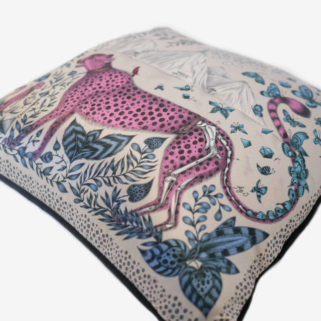 Hand-drawn illustrations adorn the Cheetah Cushion, including animalistic foliage and anatomical details.