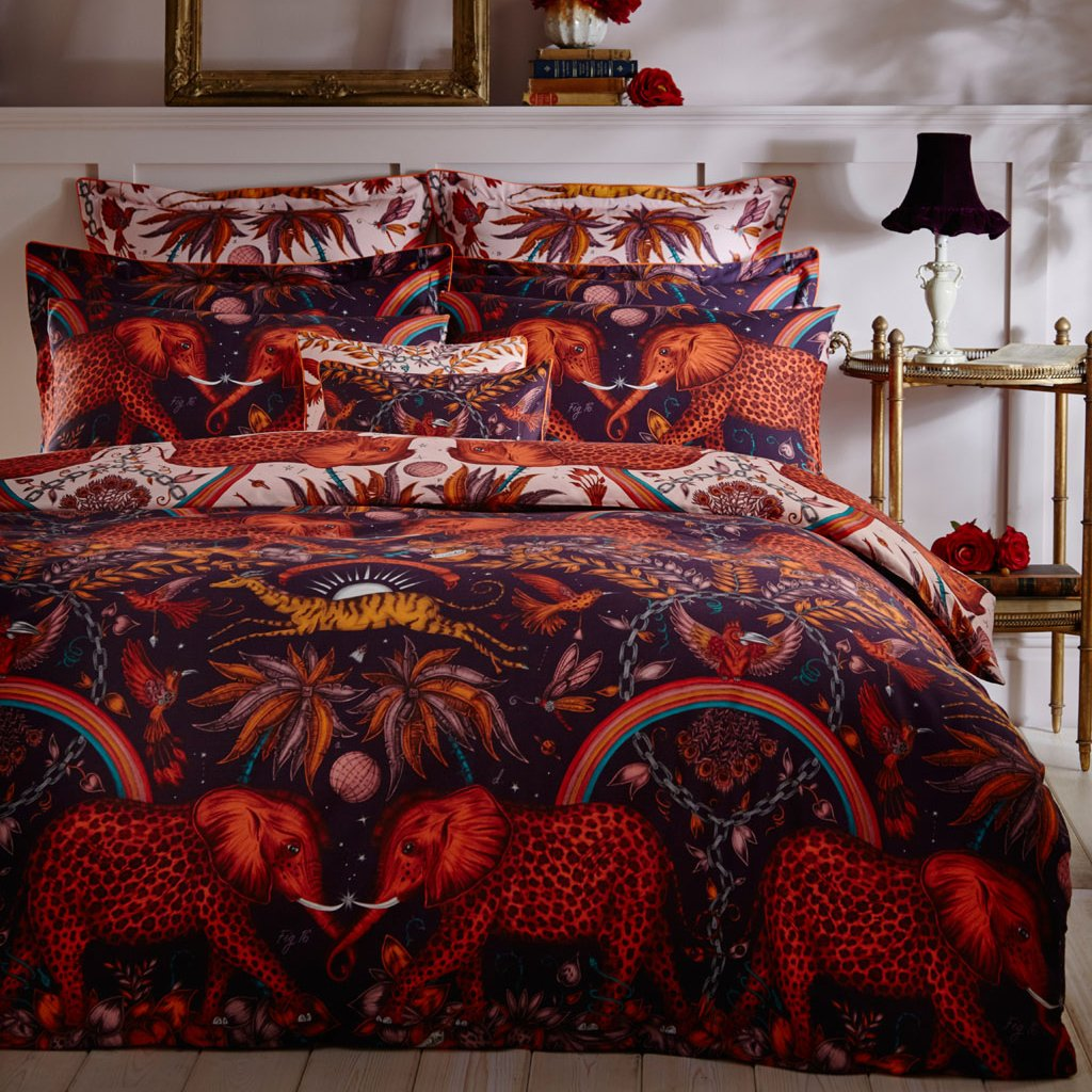 The Zambezi illustration features striking spotted elephants, winding foliage, leaping gazelles and surreal details. The Zambezi wine bedding set designed by Emma J Shipley, made in collaboration with Clarke & Clarke are 200 thread count cotton sateen reversible pillowcases, that are sure to add the ultimate maximalist touch to your bedroom.