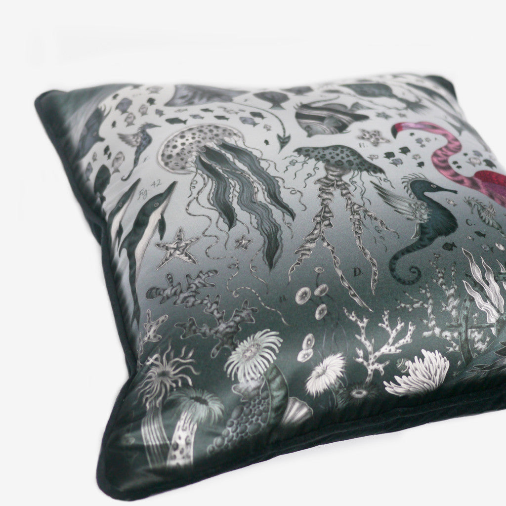 Deep, tonal greys are highlighted amongst accents of pink on this luxurious silk and cotton printed cushion.