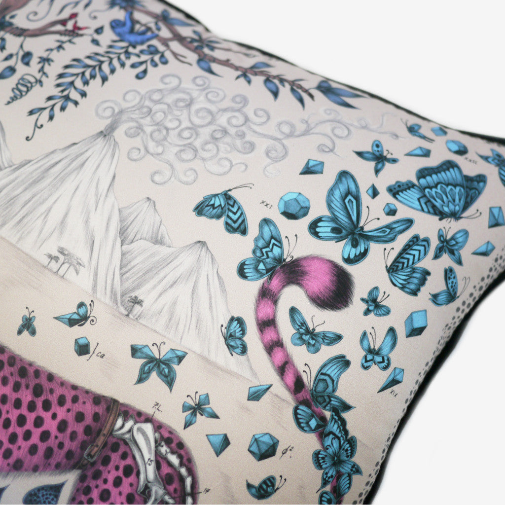 Butterflies surround the tail of the pink cheetah on the silk and cotton cushion.