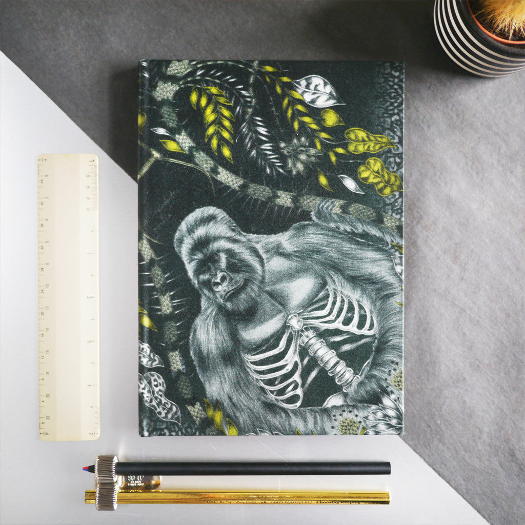 A lifestyle shot of the Emma J Shipley silk journal with the Silverback design in gold.