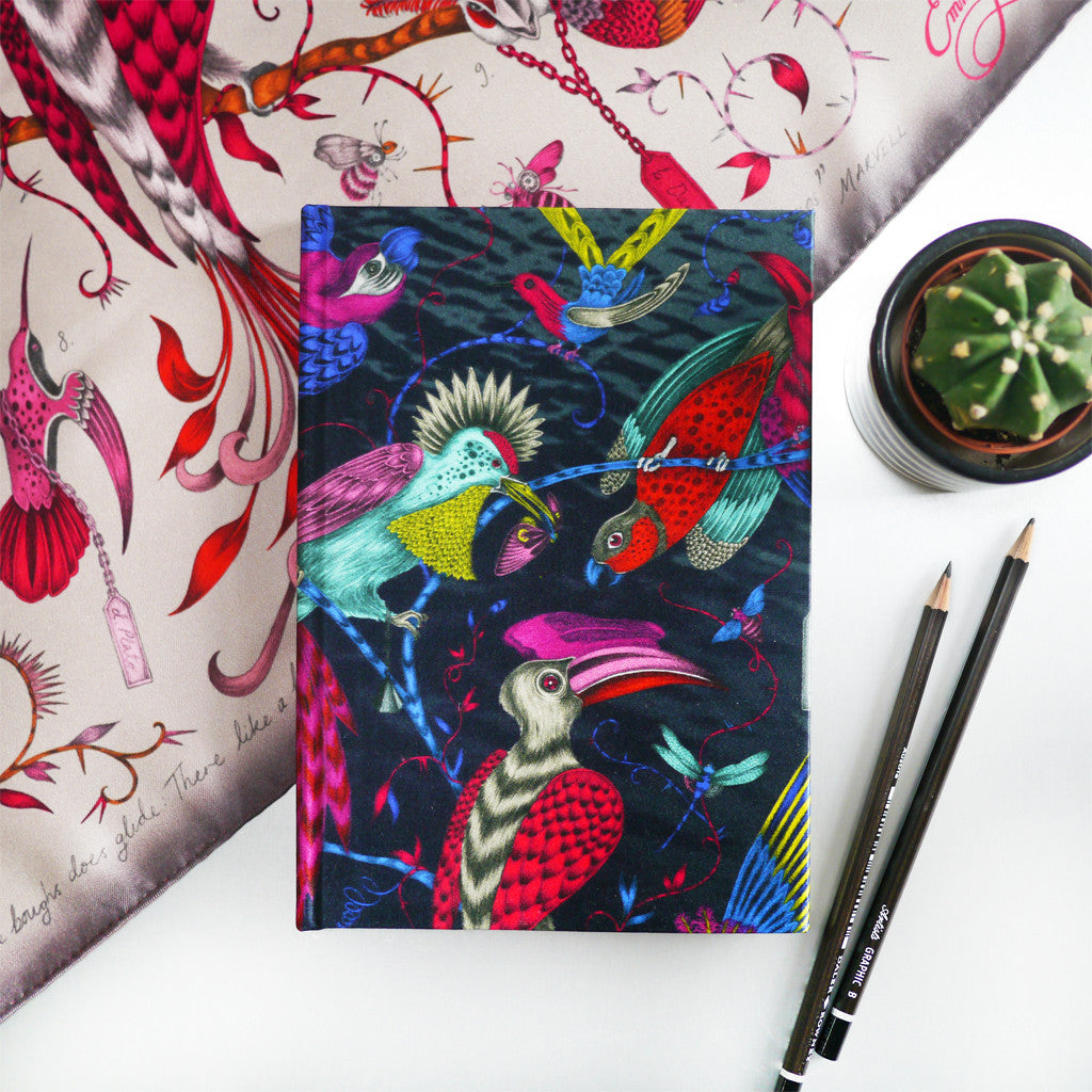 A lifestyle shot of the Emma J Shipley silk journal with the Audubon design in multiple colours.