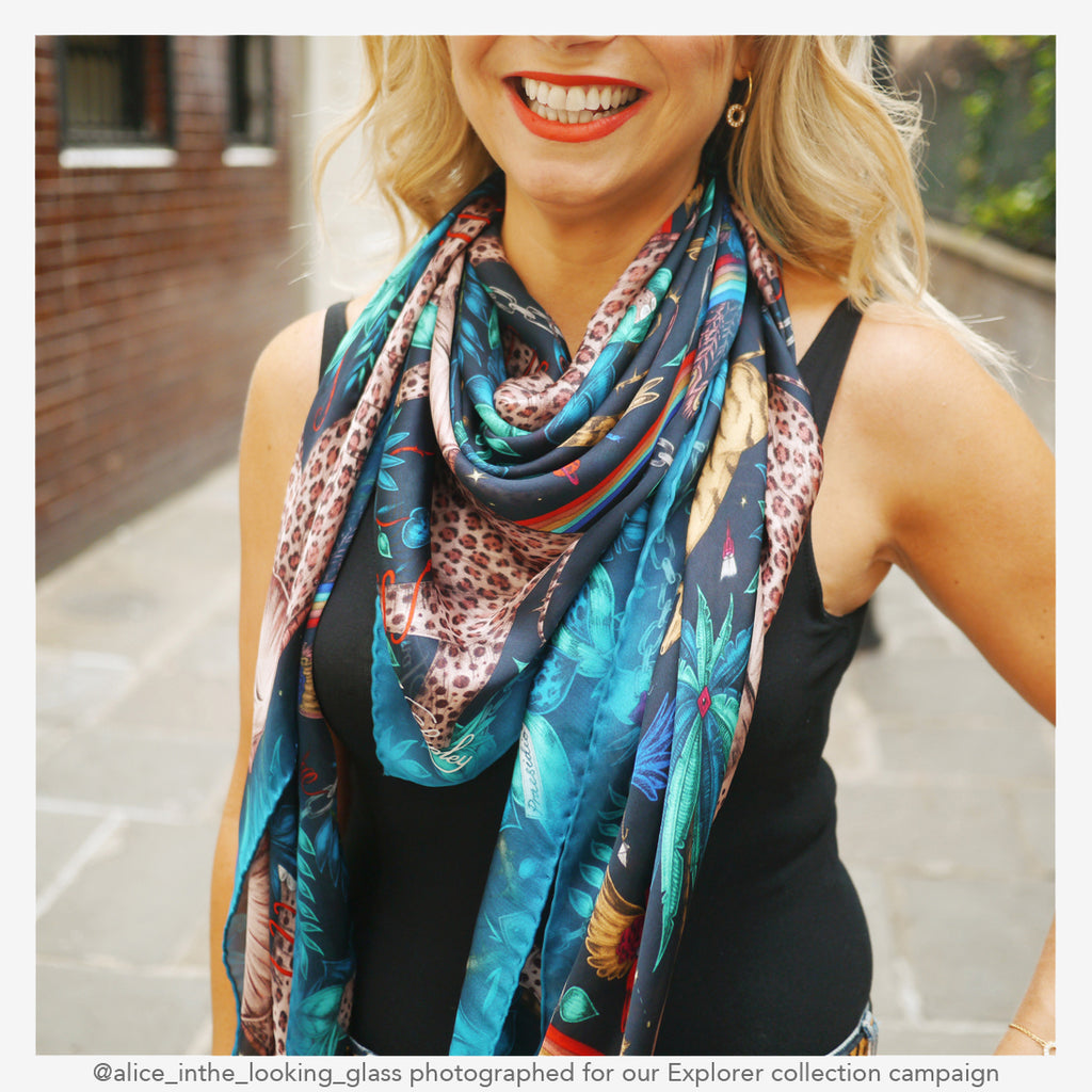 a close up campaign shot of the Zambezi silk chiffon scarf shows off the bright colours and hand drawn details
