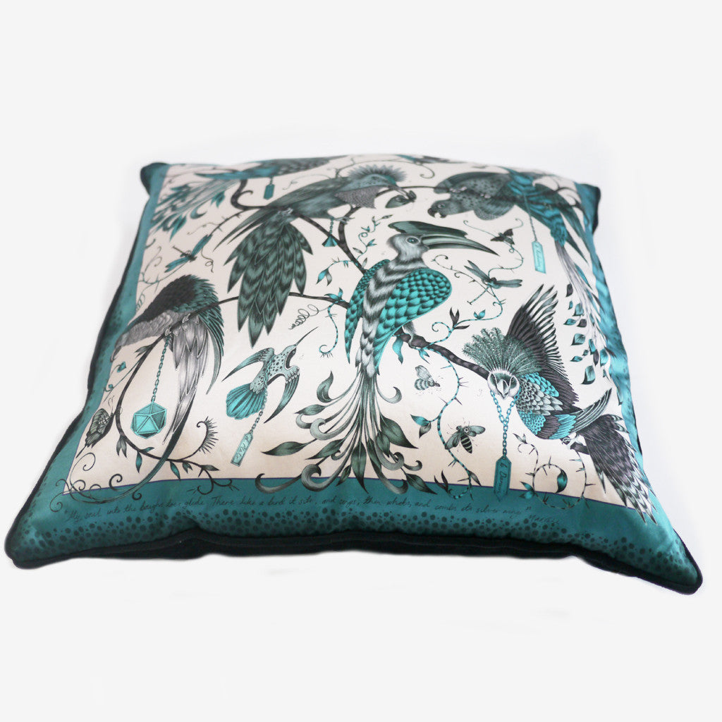 The luxurious silk and cotton blend displays fantastical parrots and hornbills