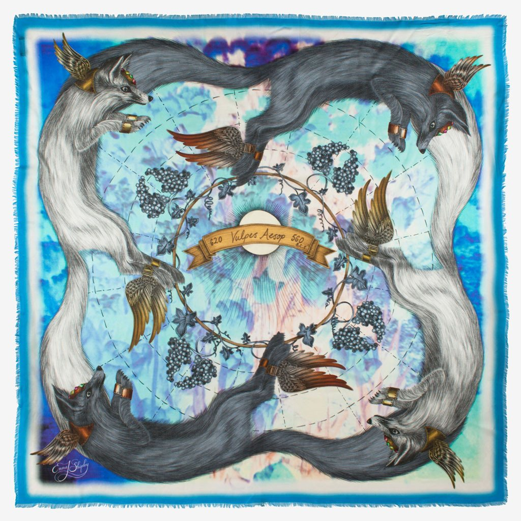 Emma J Shipley's luxury scarf design featuring arctic foxes on blue modal and cashmere.