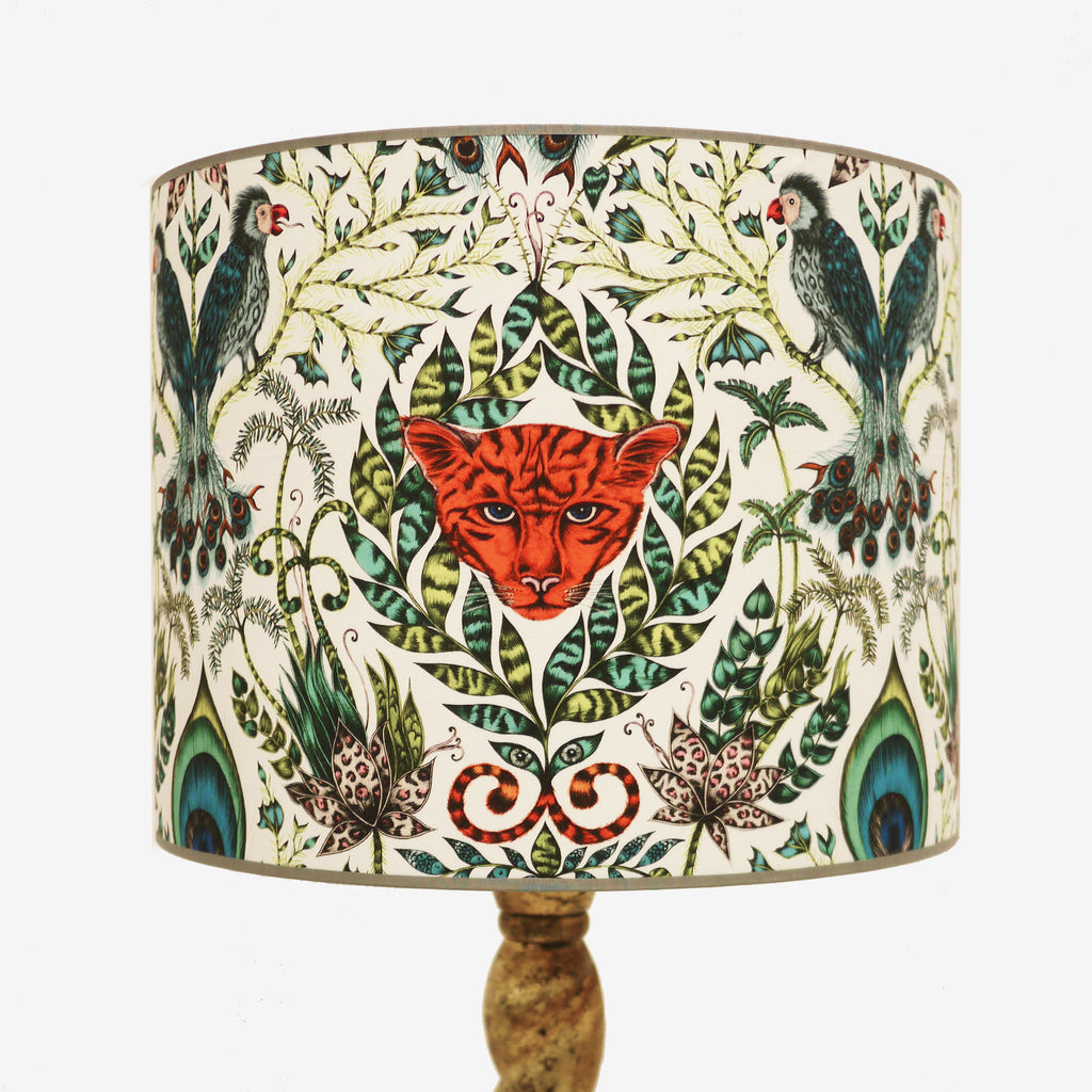 A statement 15 inch lampshade with jungle magic aesthetic, that features exotic parrots and a jaguar, amongst foliage