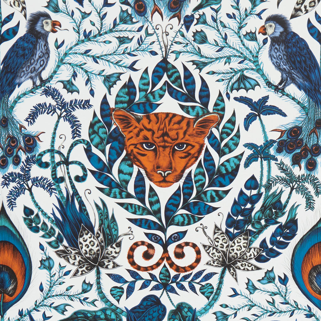 The ultimate contrast of royal blues and teals, with the fiery orange jaguar head is dramatic. The Amazon wallpaper designed by Emma J Shipley x Clarke & Clarke