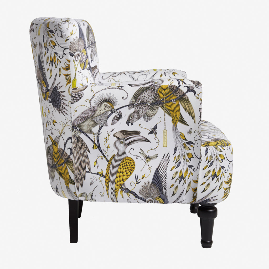 The gold Audubon Dalston Chair is a sumptuous armchair designed by Emma J Shipley for Clarke & Clarke. It's upholstered with the Audubon cotton satin fabric from the Animalia range