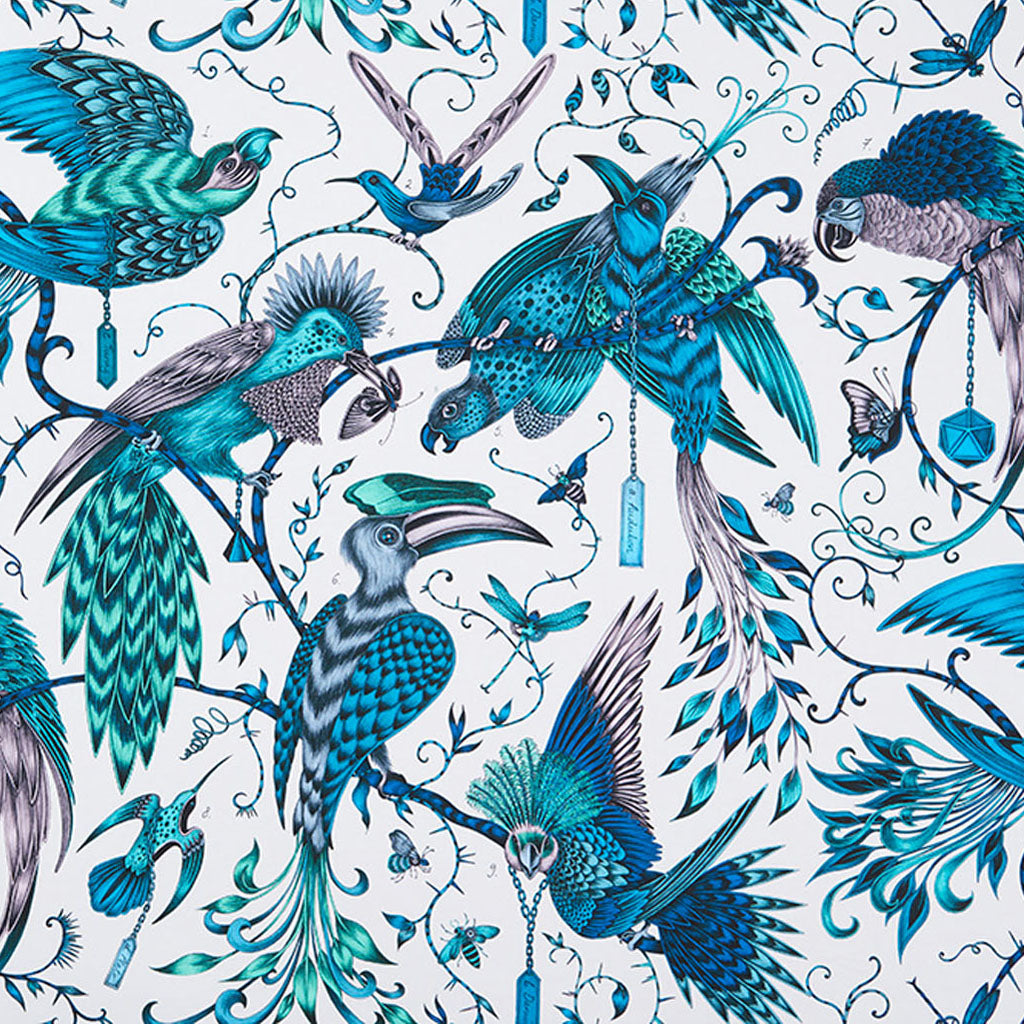 The Audubon cotton satin fabric designed by Emma J Shipley x Clarke & Clarke in the teal colour way show tropical birds of paradise surrounded by fauna