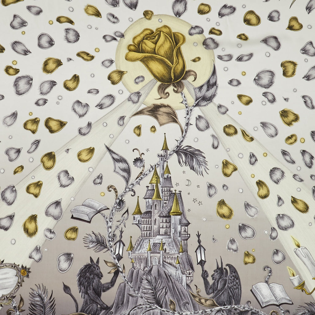 Detailed image of the enchanting castle featured on the Emma J Shipley luxurious Silk Chiffon Scarf in Gold, finished with the cursed rose and petals filling the scene.