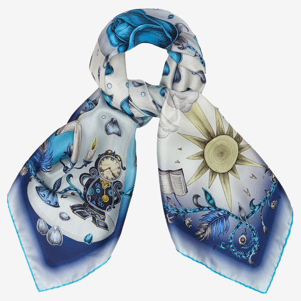 A tied example of the blue Beauty and the Beast Classic Silk Scarf