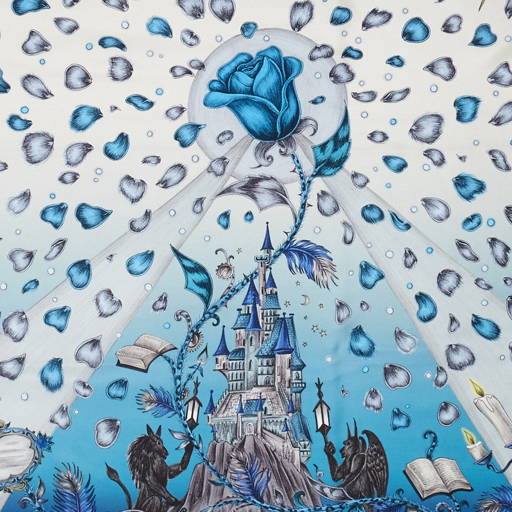 Detailed image of the enchanting castle featured on the Emma J Shipley Classic Silk Scarf in Blue, complete with the cursed rose and petals.