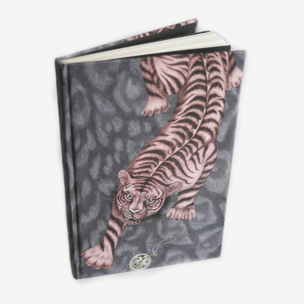 Inspired by classical Greek and Roman mythology, the Tigris Silk Notebook exhibits a striking tiger, prowling eagerly down the luxurious book cover.