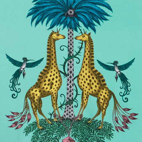 A close up of the Creatura cotton satin fabric by Emma J Shipley for Clarke & Clarke, featuring spotted giraffes and zebras with unicorn horns, in turquoise, yellow and teal.