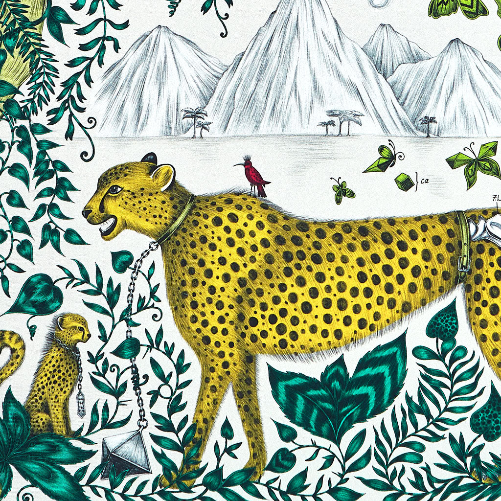 A small bird rides the bright yellow cheetah in the Emma J Shipley design, also featuring a baby leopard, vines and mountains, this design creates fantasy