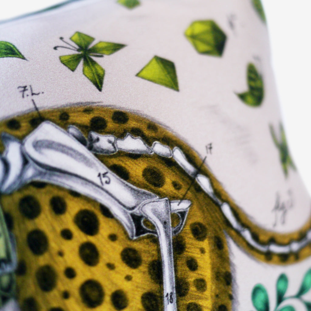 The Cheetah Double Bolster Cushion by Emma J Shipley features an arresting jungle scene