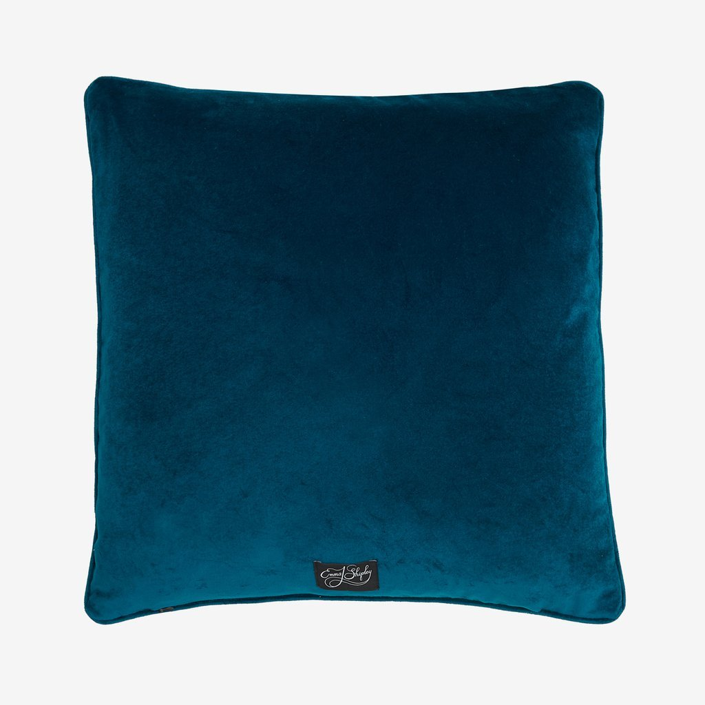 Back view of the jewel blue velvet backing of the Kruger II cushion, complete with an Emma J Shipley label