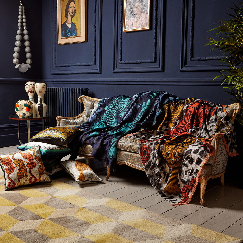 Living room inspiration by Emma J Shipley, featuring Tiger throws, cushions and dark walls