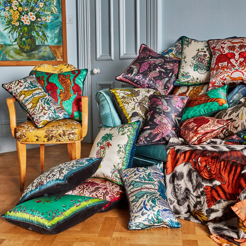 A lifestyle photo of Emma J Shipley's luxurious signature cushion collection, the perfect addition to your home