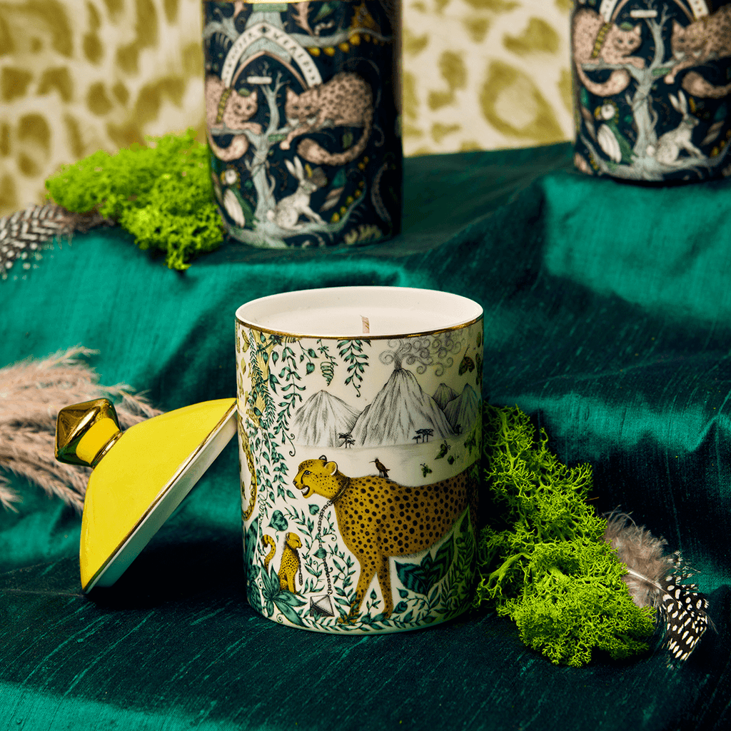 A closer look at the Cheetah candle with the lid, featuring real gold details with lemon zest and vetiver scents