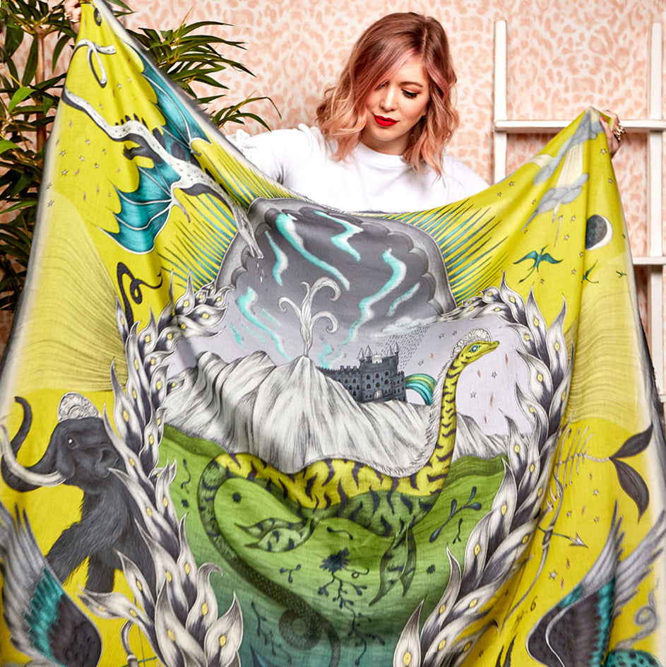 The Highlandia Collection is full of spring summer colours including this fantastical lime Highlandia Modal Cashmere Scarf worn by Emma J Shipley herself. The scarf features the Loch Ness monster, a Mammoth and a mystical backdrop inspired by the Scottish Highland