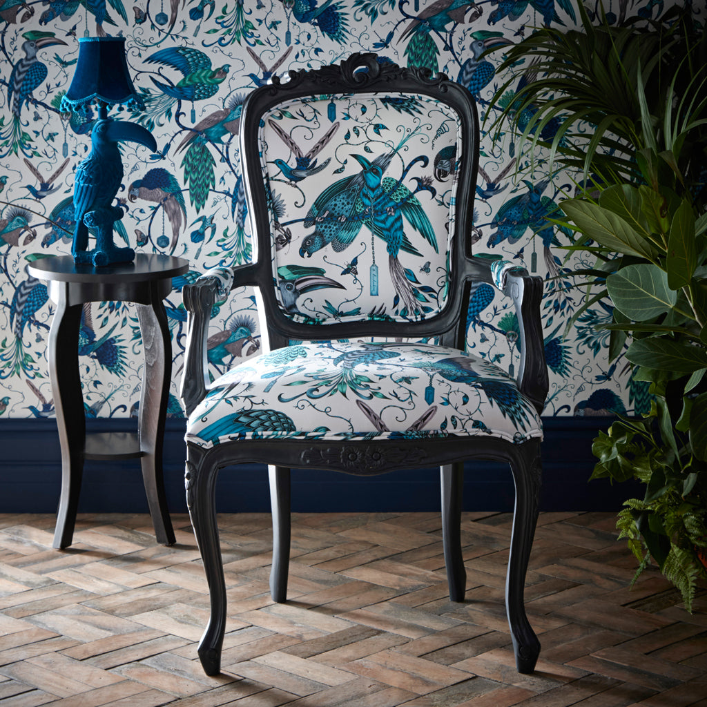 The beautiful Antoinette Chair in the Audubon cotton satin is an upholstered occasion chair designed by Emma J Shipley and Clarke & Clarke as an extension of the Animalia collection
