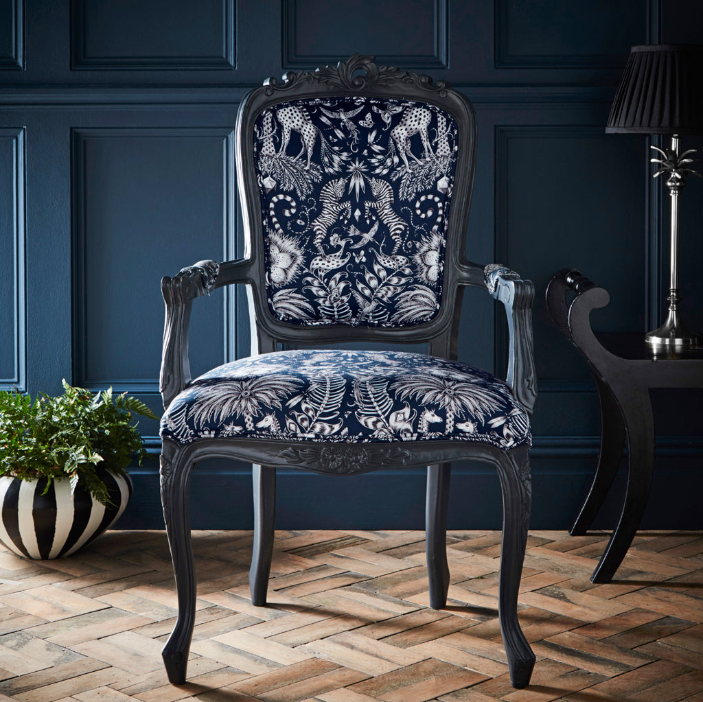 Beautiful navy Kruger Antoinette Chair designed by Emma J Shipley for Clarke & Clarke is a stunning safari-inspired design